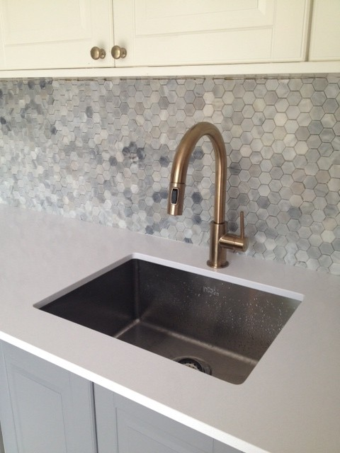 Delta Trinsic faucet robinet champagne laiton