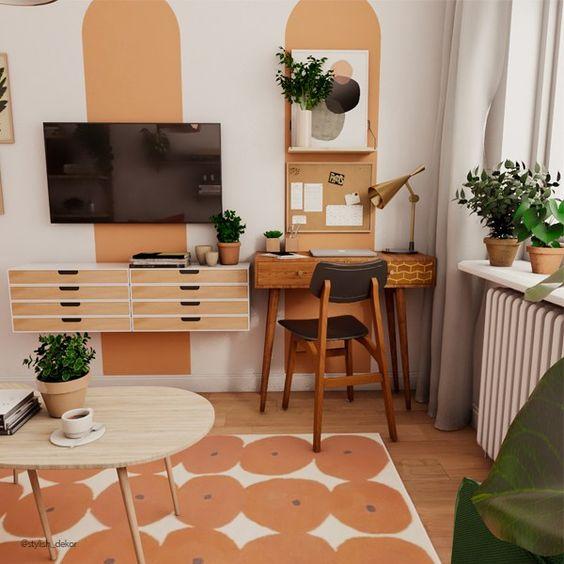color bloc demi cercle orange pour délimiter un petit coin bureau à la maison